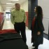 Harlan County High School senior Sierra Hatfield talked with Dave Gash of Jostens as she tried on a graduation gown. Seniors are making their choices as they prepare for graduation in May.