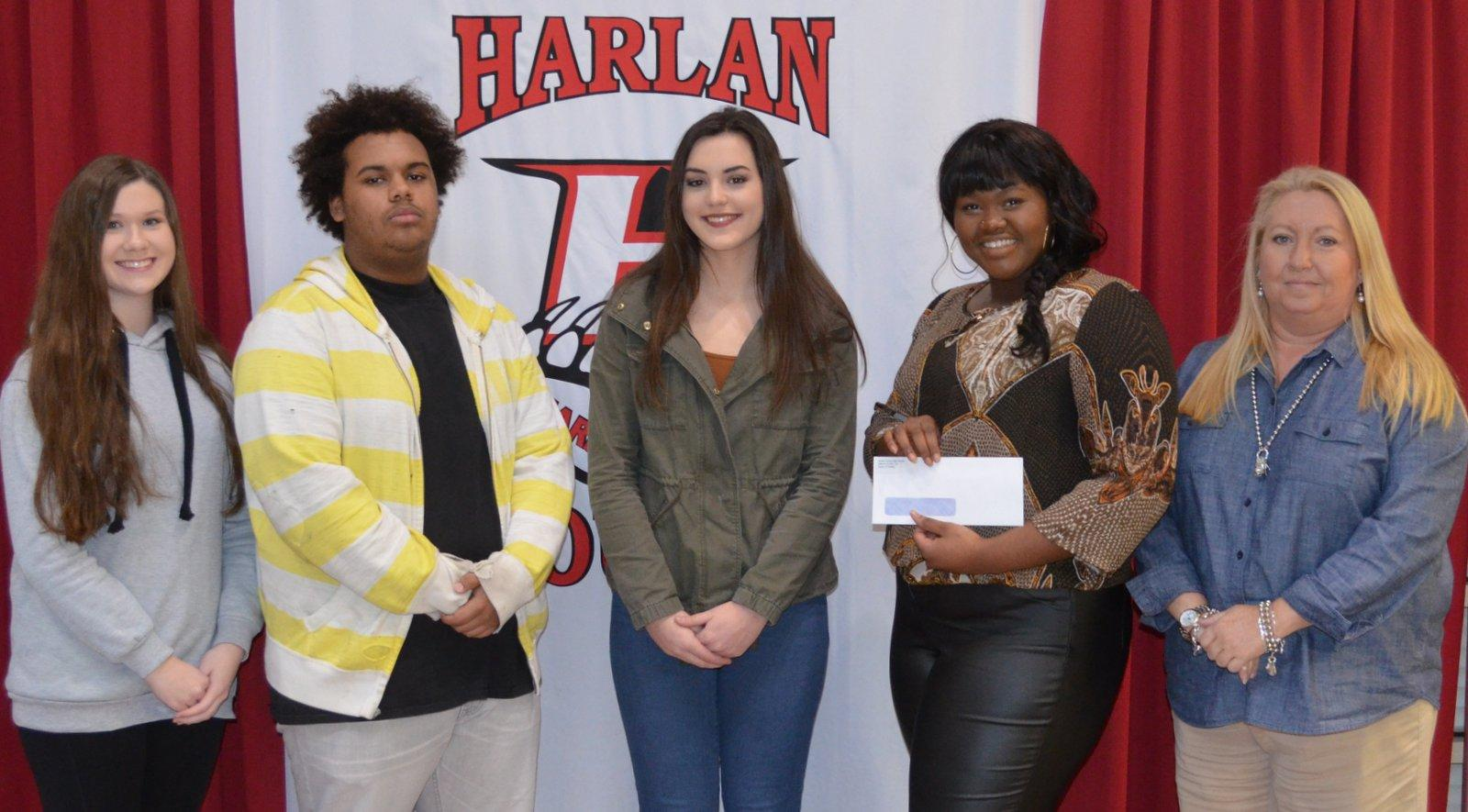 Harlan County High School Beta Club officials include, from left: Autumn Dunaway - vice president; Terrance Stephens - treasurer; Miranda Cook - secretary; Daesha Carr – president; and Tina Lawson, sponsor.