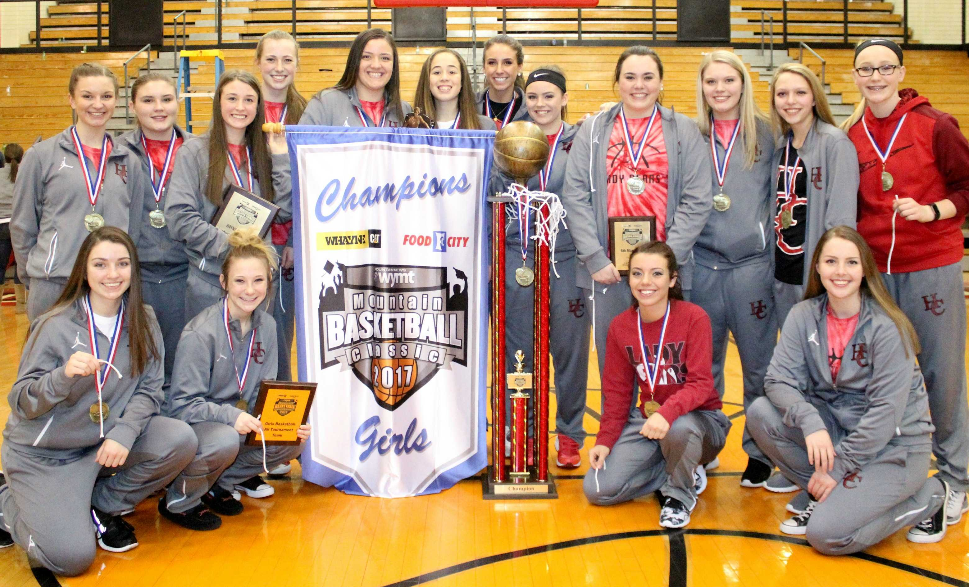 The Harlan County Lady Bears are pictured with their championship trophy and banner after winning the WYMT Mountain Classic title, the first in county history. Team members include, from left, front row: Morgan Blakley, Phebe McHargue, K.K. Johnson and Dixie Ewing; back row: Rebecca Middleton, Macie Napier, Hannay Gaw, Lainey Cox, Kaylea Gross, Shelby McDaniel, Blair Green, Breann Turner, Morgan Napier, Brooklyn Wood and Emily Long.