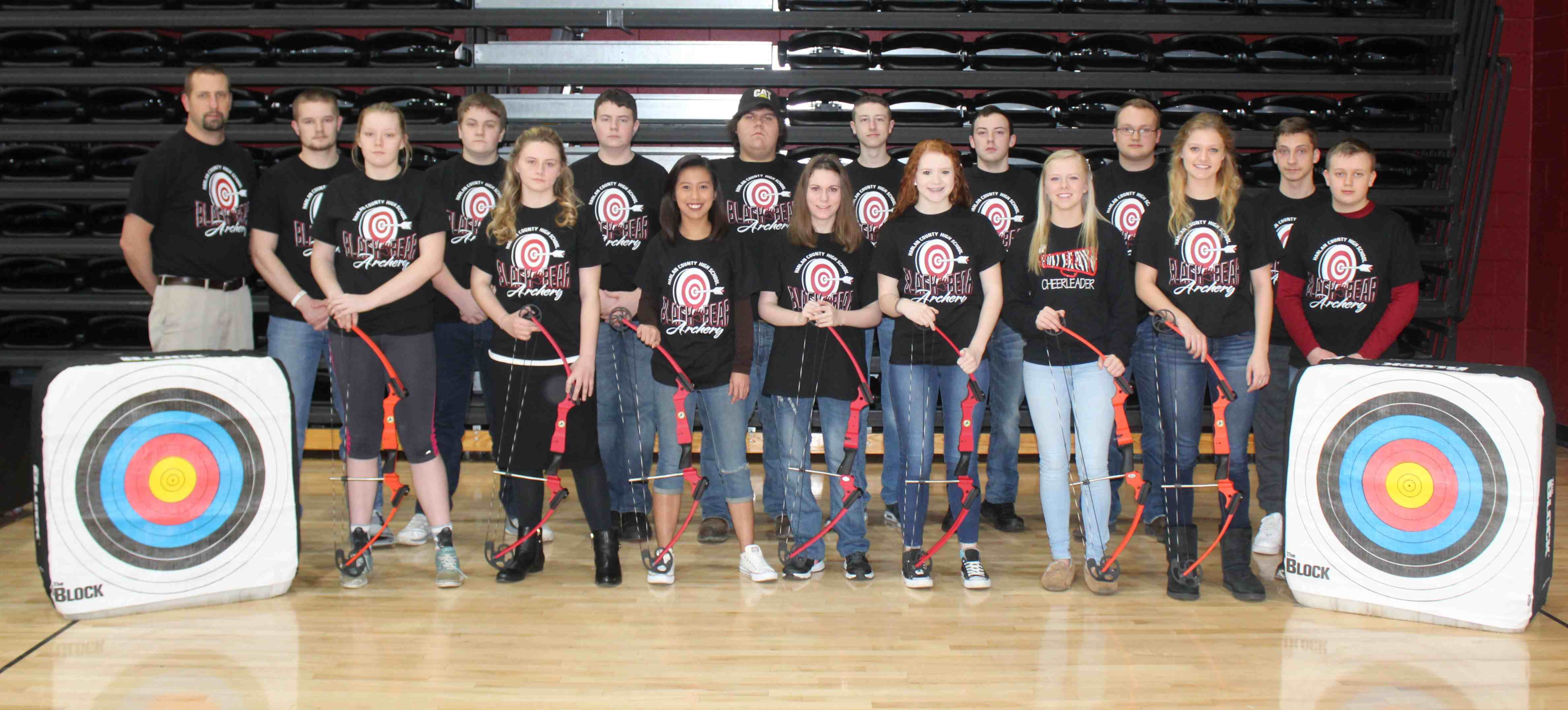 John Henson / Bear Tracks  Members of the Harlan County High School archery team include, from left, front row: Andrea Dean, Sasha Patterson, Rochelle Paguio, Kayla Bolin, Emily Evans, Baili Boggs, Breanna Faulkner and Dylan Gross; back row: coach Damon Lewis, Drew Nolan, Eli Lewis, Jeffrey Ramsey, Michael Ellison, Jimmy Rouse, Paul Browning, Calvin Gross and Trevor Wilson; not pictured: Shaun Warren and Lonnie Whitehead.
