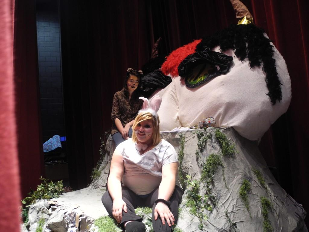 Kimberly Cox (back) and Caitlin Sowards are pictured with Gruff, a character in the play Where the Wild Things Are, during a performance Thursday at Harlan County High School. Drama students at HCHS performed the play for Harlan County High School and local elementary school students at the HCHS Auditorium.