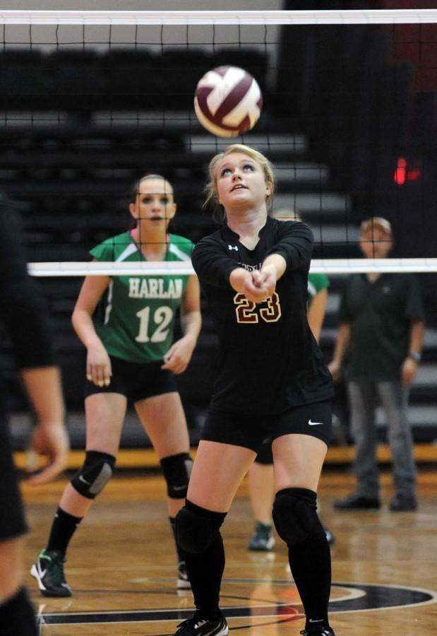 Harlan County senior Brittany Clem set the ball in district volleyball action Tuesday. Clem set up several of her teammates for kills throughout Harlan County's four-set win over Harlan.