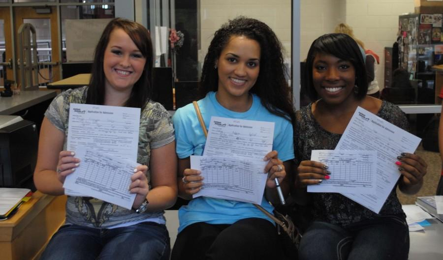 Kayla Curry, Sierra Hatfield and Deona Mimes were among the Harlan County students who registered for dual credit classes earlier this week at the HCHS library.