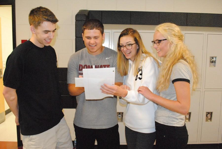 Harlan County High School Link Crew leaders, from left, Cameron Carmical, Rhett Alred, Emma Day and Kali Nolan worked on plans for the program, which will begin during the 2016-2017 school year and is designed to help incoming freshmen adapt to high school by working with older students.