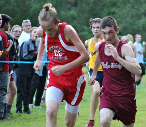 Photo by Jessica Turner  Harlan County senior Dalton Shepherd gave everything he had at the finish line to edge (Wise) Central's Sam Houston, giving HCHS the team title in a meet Tuesday at the Harlan County High School course.