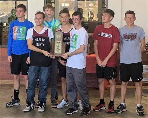 Photo submitted  Members of the Harlan County High School regional championship cross country team include, from left: from left: James Chasteen, Seth Sanders, Alex Lewis, Josh Lee, Dalton Shepherd, James Dean and Zackary Carmical.