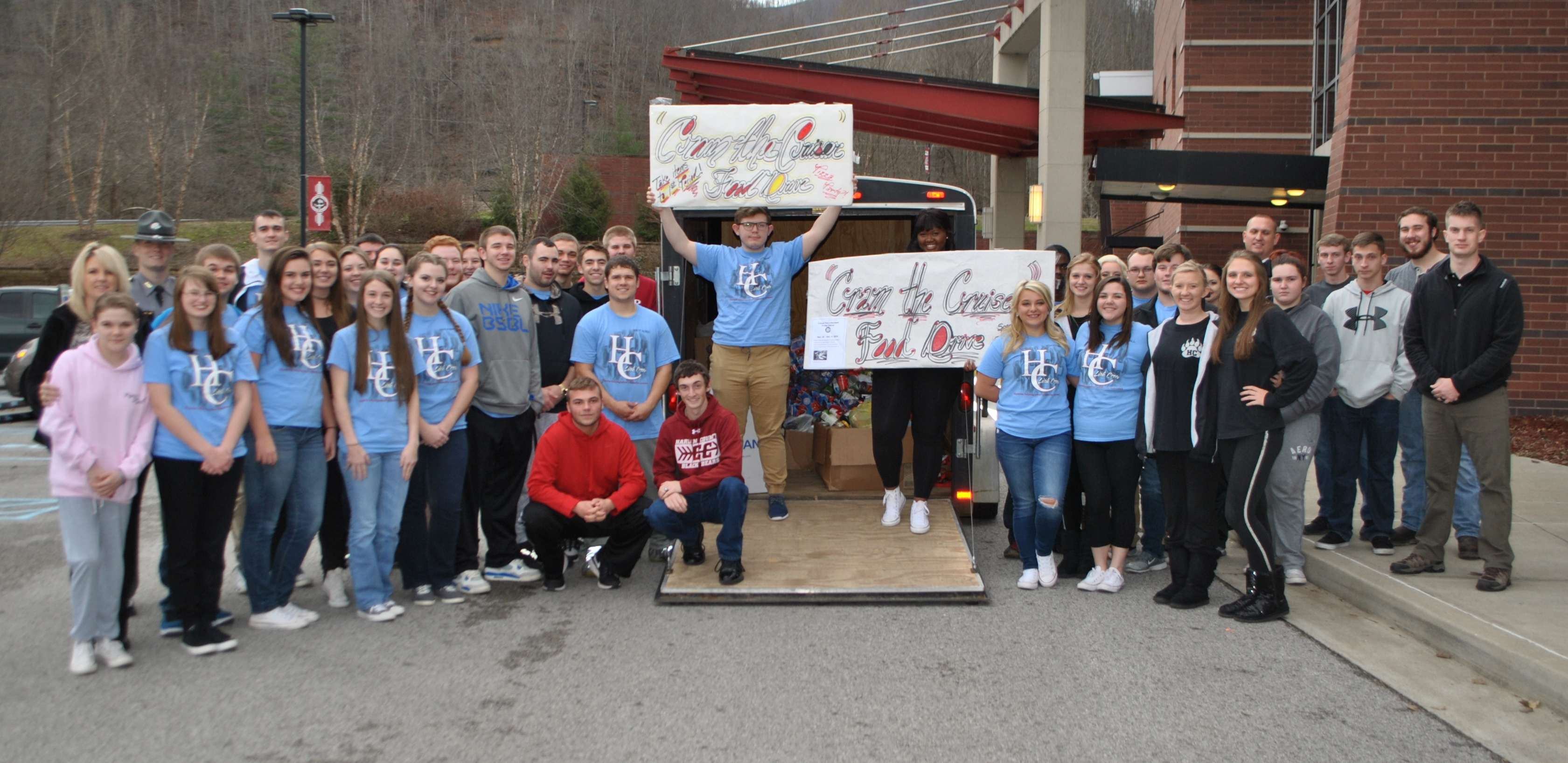 Members of the Harlan County High School Link Crew members are pictured after collecting over 1,100 cans as part of the Cram the Cruiser Food Drive.