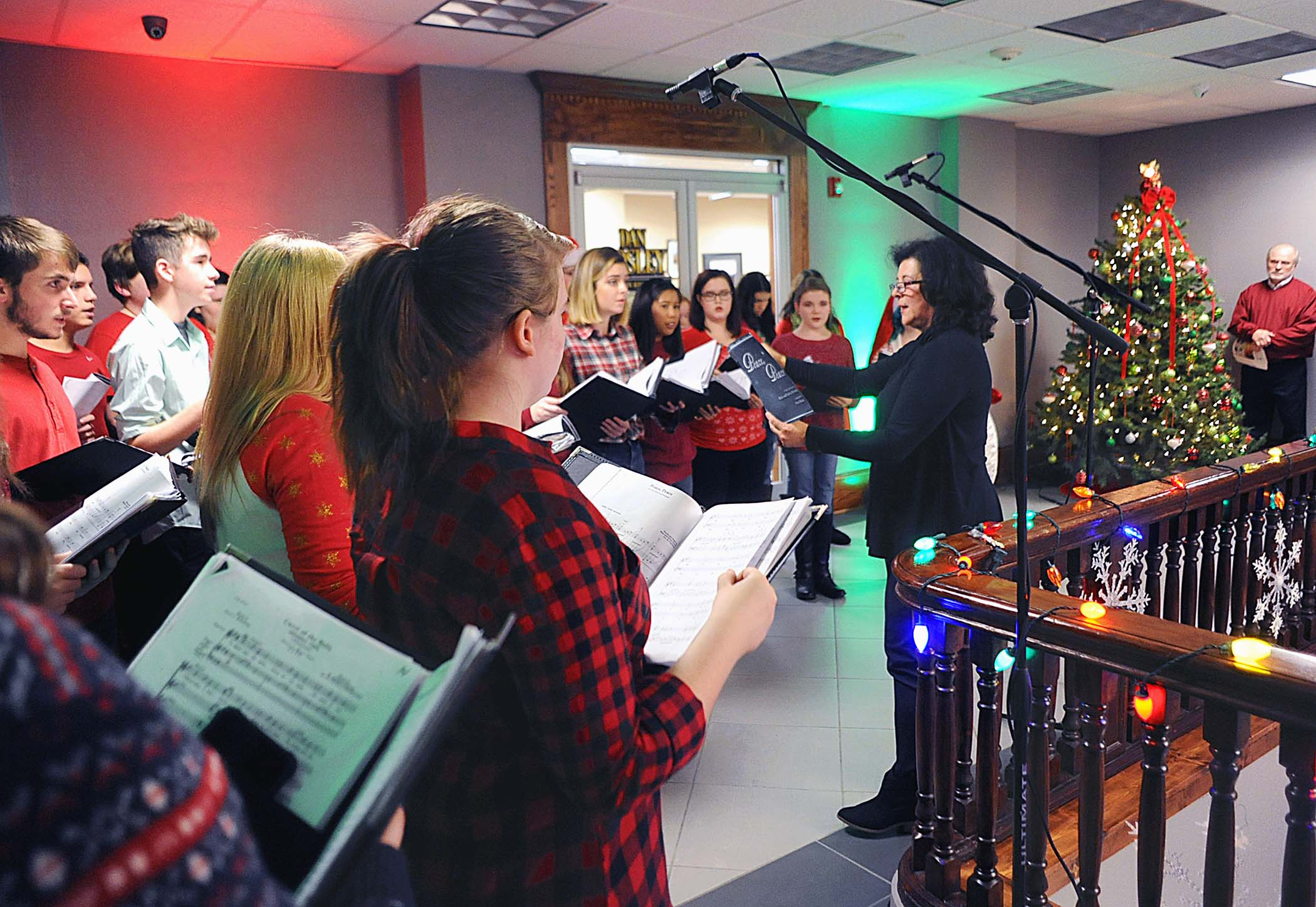 The annual Harlan County Courthouse caroling program was held Tuesday evening as groups took part in the event sponsored by the Harlan County Fiscal Court, courthouse staff and the Harlan Arts Council. One of the many groups to liven up the cold night was the Harlan County High School Choir, under the direction of Jeanne Lee.