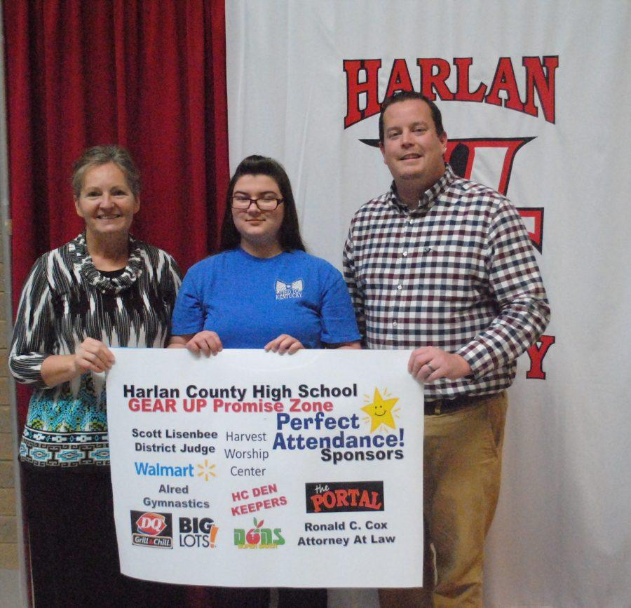 Bethany Mitchell, a ninth-grade student at HCHS, was the winner of $460 is cash and prizes for perfect attendance. She was presented the check by GEAR UP academic specialists Tammy Fields and Jonathan WIreman