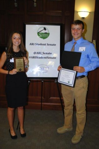 Harlan County High School was represented at the ARI Student Senate induction ceremonies on Thursday in Pikeville by senior Breanna Epperson and junior Garry Henson. The ARI Student Senate is a student agency component of the U.S. Race to the Top Grant received by Kentucky Valley Educational Cooperative (KVEC) and is comprised of students from 17 school districts in the region. Each district selects one junior and one senior to send to the Senate. Over the coming year, Student Senate members will work toward a more participatory role for students, as full partners in their education, through avenues of academics, community service, and school culture, focusing on themes of community health, economic development and energy.