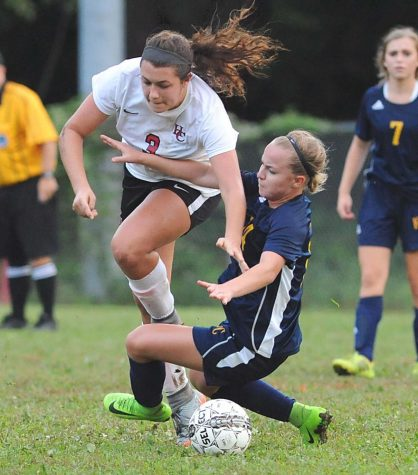 Harlan County's Madison Blanton collided with a Knox Central player in soccer action last week at the James A. Cawood field. HCHS won 4-1 in its home opener, improving to 2-1-1 on the season.