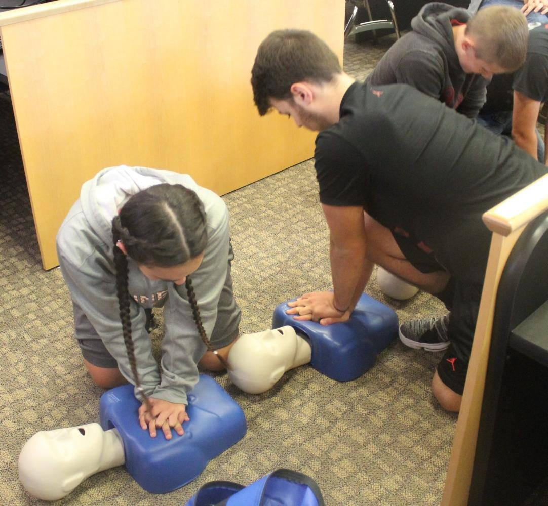 Sabrina Harris and Casey Lee practiced chest compressions in their CPR session at HCHS.
