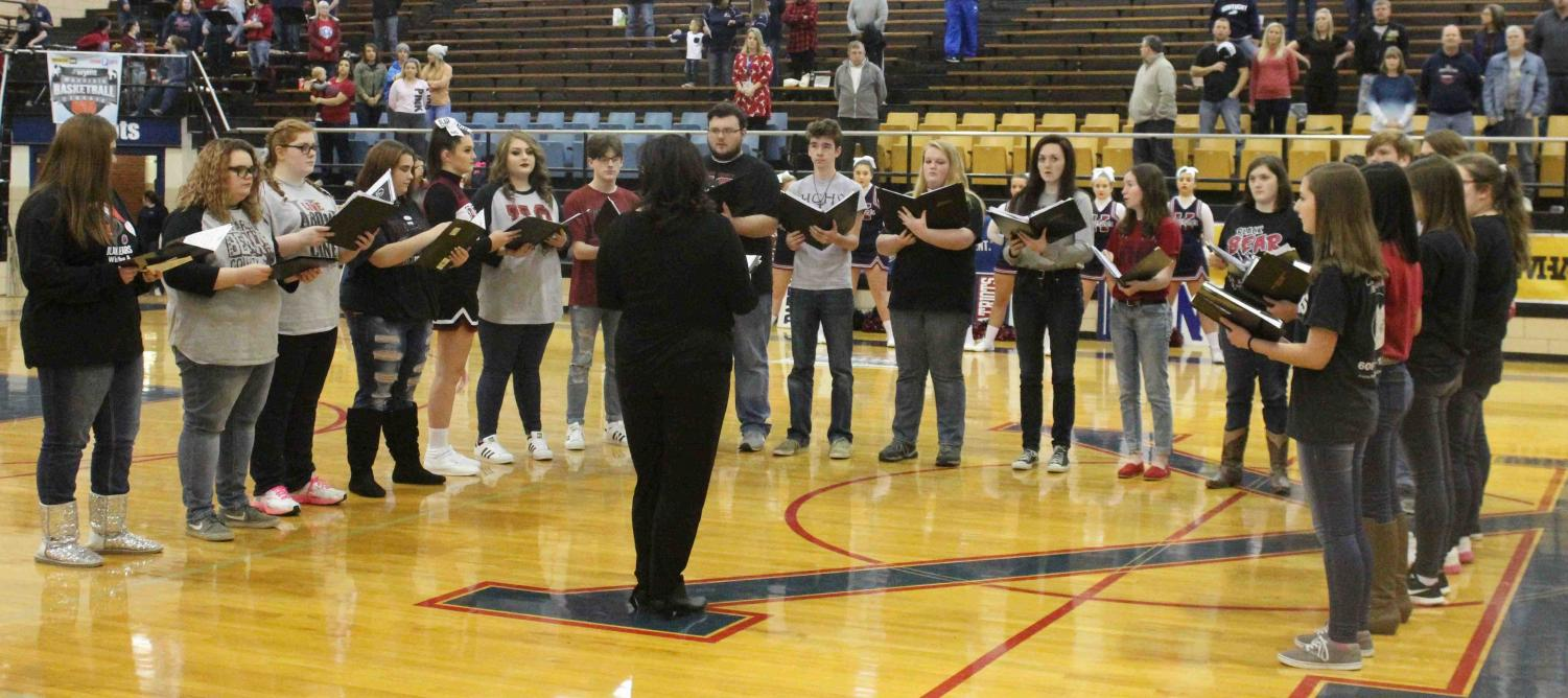The Harlan County High School choir, under the direction of Jeanne Ann Lee, performed the National Anthem during the WYMT Mountain Classic on Wednesday at Knott Central High School.