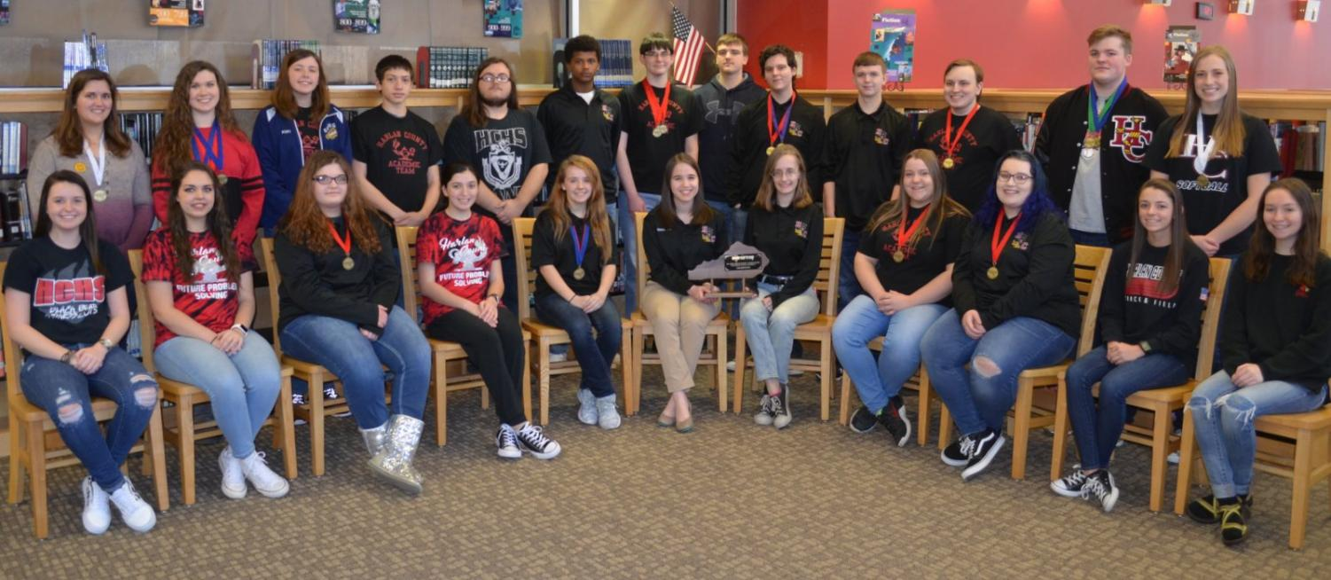 Members of the first place 52nd District Governor's Cup team from Harlan County High School are, from left, front row: Jordan Blevins, Chelsey Caldwell, Amber Blanton, Hannah Pittman, Janice Dean, coach Alexandra Nau, Shayla Hamlin, Bridgett Craig, Kaylee Major, Breanna Epperson and Emma Pinkley. back row: Sophia Sergent, Autumn Dunaway, Kiki Dean, James Osborne, Johnny Smith, Bitty Foster, Edmund Dye, Brett Roark, Luke Parker, Jared Lewis, Cody Hall, Will Scott and Lainey Cox. Not pictured are team member Dacey Bailey and assistant coach Virginia Rice.