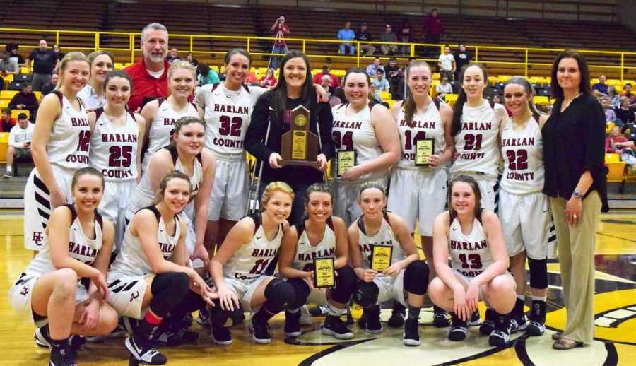 The+Harlan+County+Lady+Bears+are+pictured+with+their+championship+trophy+after+defeating+Harlan+in+the+52nd+District+Tournament+finals.