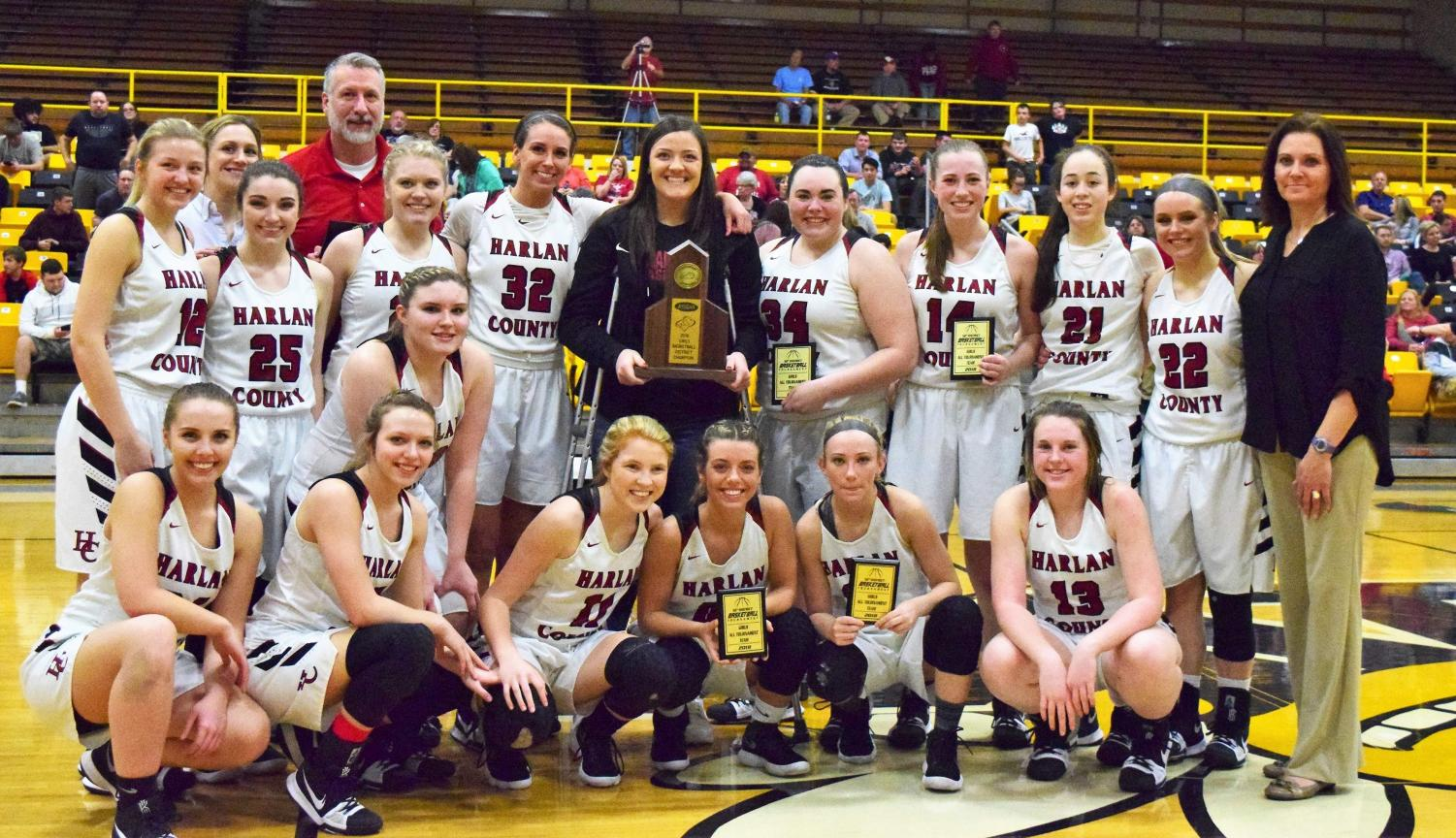 The Harlan County Lady Bears are pictured with their championship trophy after defeating Harlan in the 52nd District Tournament finals.