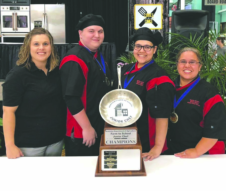 The Harlan County High School Junior Chef Team of Kieran Chadwick and Selena Moreno and coaches Chasity McCarty and Leilani Kelly are shown with top award received Friday after being named the top team in the 2018 Farm to Chef competition sponsored by the Kentucky Department of Agriculture.