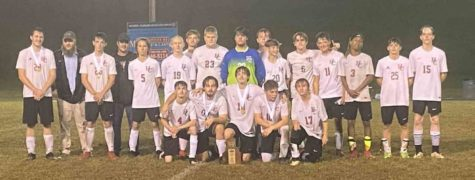The Harlan County soccer team captured the 50th District Tournament title with a 2-1 win over Barbourville on Wednesday. The 8-6 Black Bears advance to regional competition.